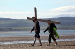 movie thumbnail, Pilgrims cross the Holy Island causeway on Good-friday 2016